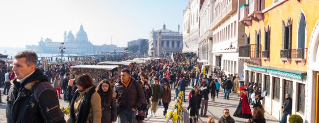Venice, Italy- February 8, 2015: Crowd of tourists on St. Mark's square-Venice, Italy.